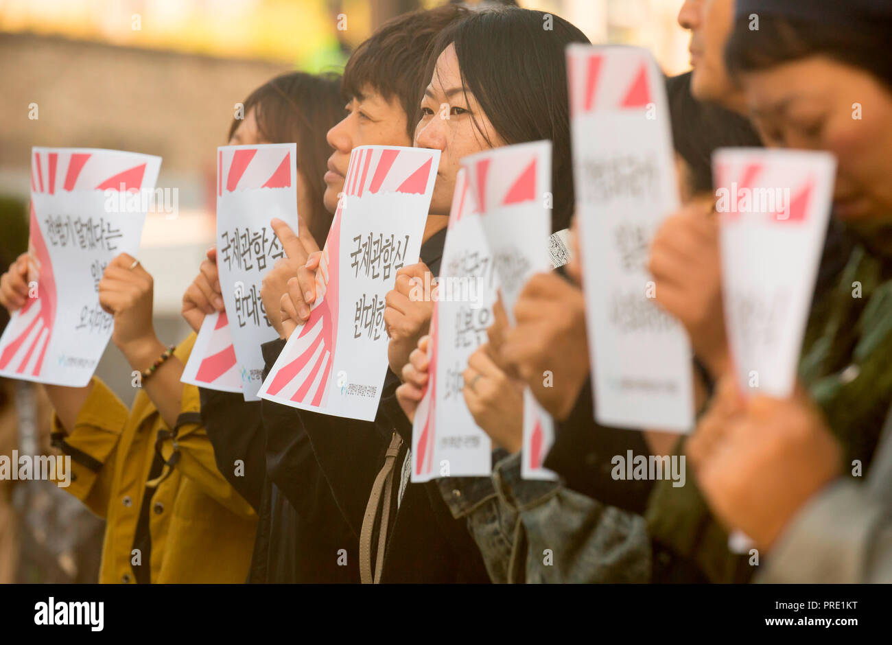 Protest against Japanese rising sun flag in South Korea, Oct 1, 2018 : South Korean activists from civic groups attend a press conference in front of the Japanese embassy in Seoul, South Korea. The protesters criticized Japan and its navy planning to display Japanese Rising Sun Flag, which protesters think as a symbol of wartime aggression, during the International Fleet Review to be held off the island of Jeju, South Korea from October 10-14. Navy ships from 15 countries including Japan, China and the U.S. will participate in the event. South Korean navy said on Sunday it remains in oppositio - Stock Image