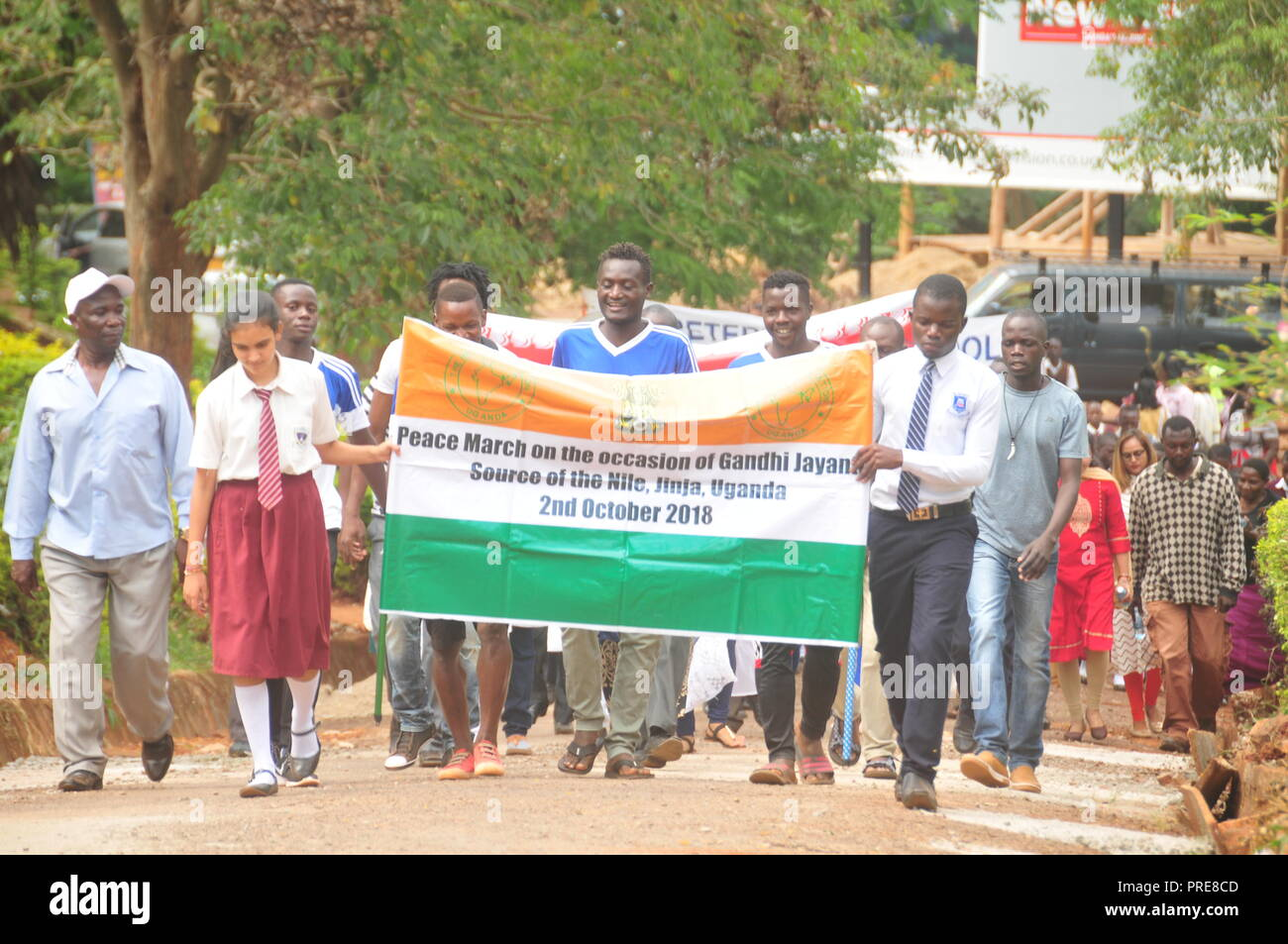 Jinja, Uganda. 2nd, October, 2018: Members of the Indian Association Uganda, officials from Busoga Kingdom Tourism Ministry and Jinja residents have joined other Indians all over the World in celebrating the 149th birthday of Mahatma Gandhi and the International Day of Non-Violence. In Uganda, the celebrations were led by the High Commissioner of India in Uganda Ravi Shankar (not in picture) at the Source of the Nile. They garlanded Mahatma Gandhi's Statue with flowers. Credit: Donald Kirya/Alamy Live News - Stock Image