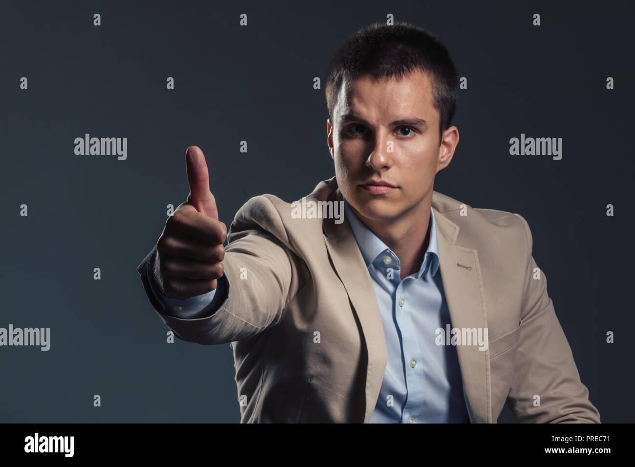 Young Handsome Businessman showing thumb up. Business Concept. - Stock Image