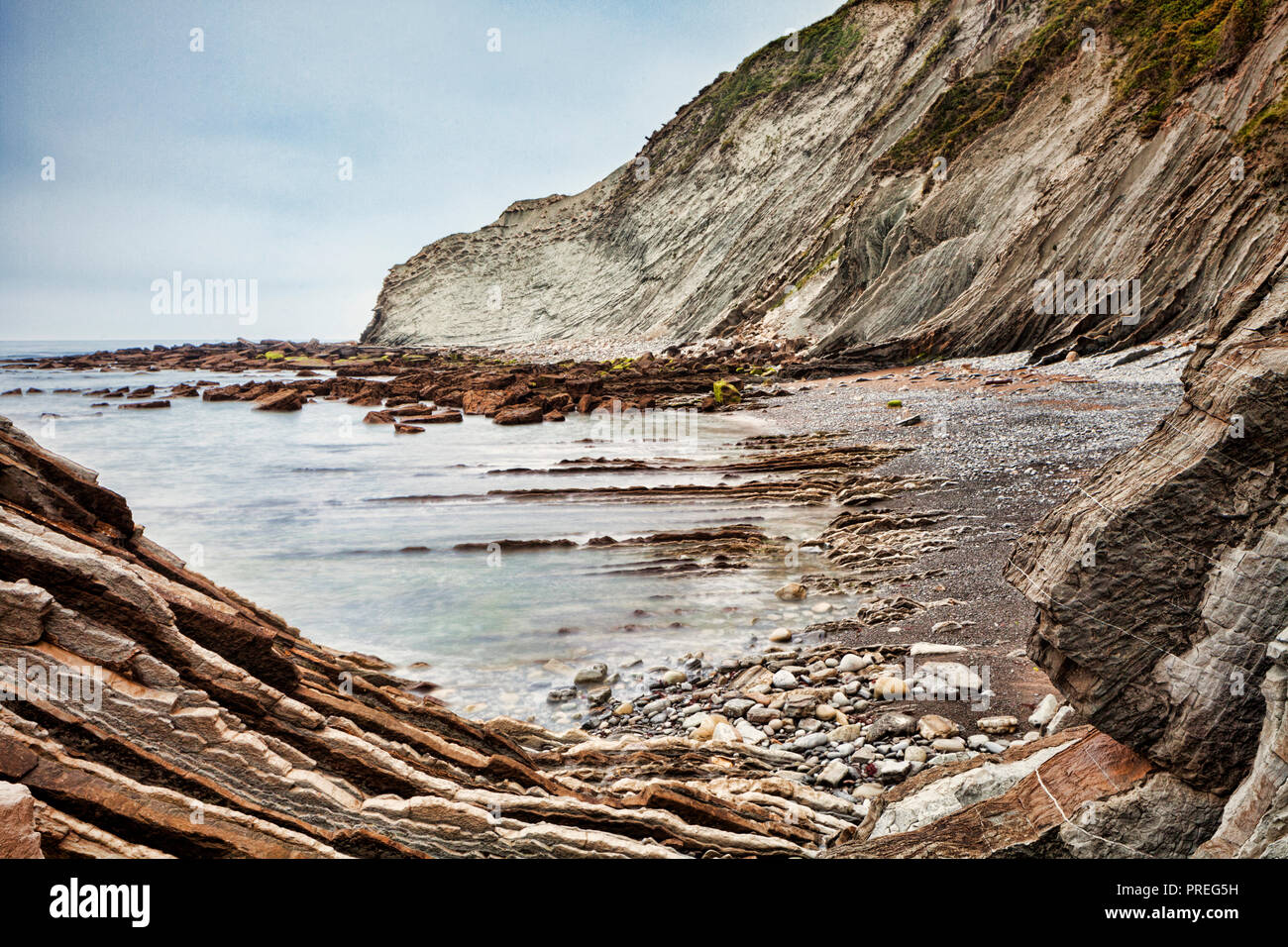 Flysch formations in the geological park at Itzurun Beach, Zumaia, Basque Country, Spain. Stock Photo