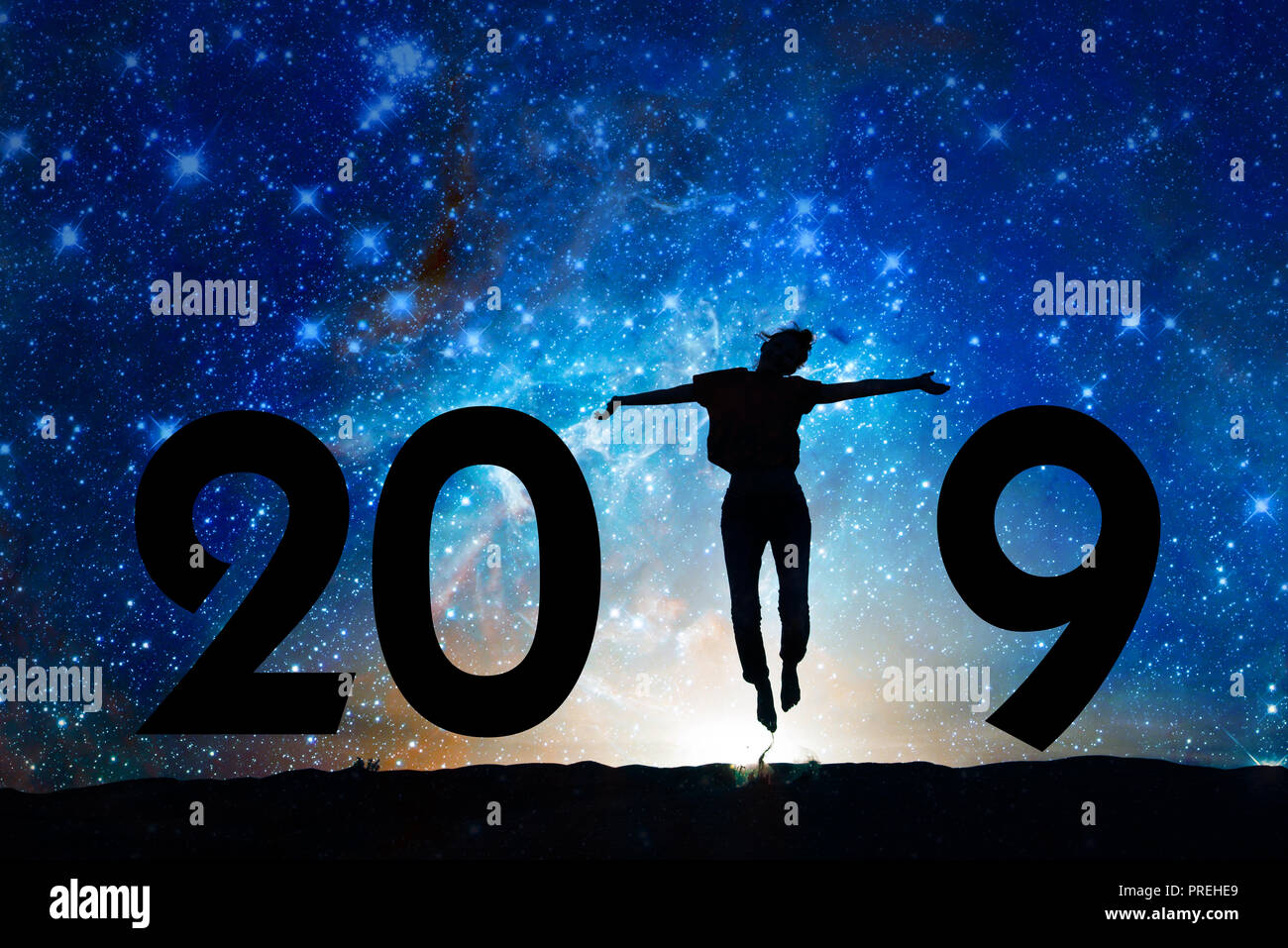 2019 new year greeting card. Silhouette of a woman jumping in the ...