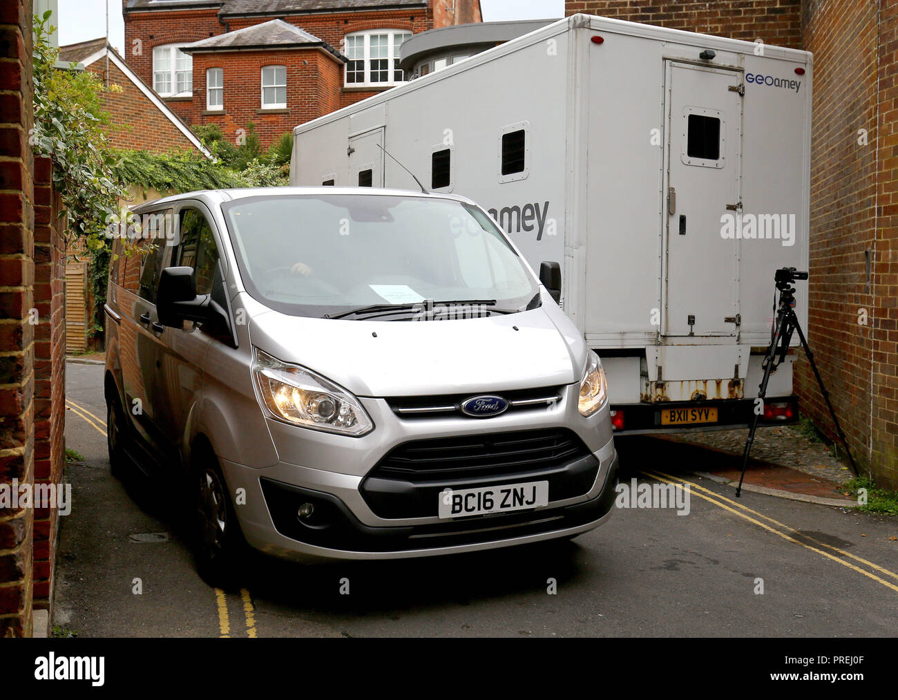 A van carrying Thomas Fisher, 22, arrives at Lewes Crown Court, East Sussex, where he will enter a plea for the alleged murder of his mother, Fiona Fisher, 51, who was found dead at her Crowborough home on April 27. - Stock Image