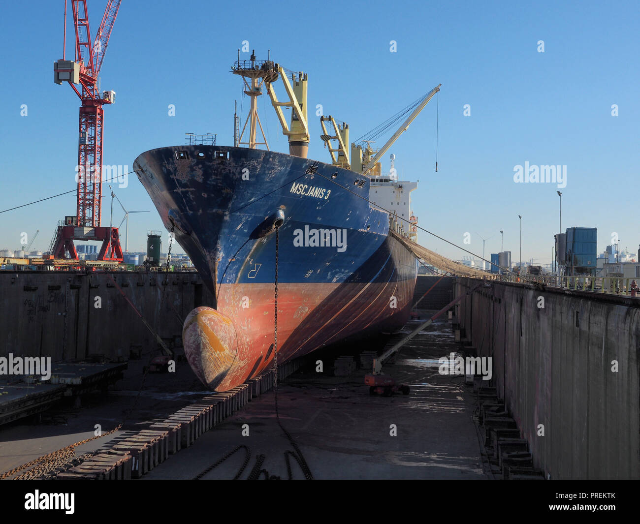 Cargo ship in dry dock for maintenance in the port of Antwerp, Belgium - Stock Image