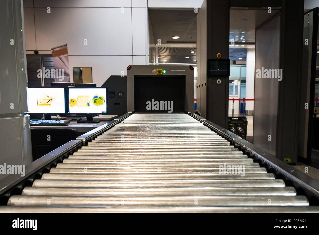 Inspection of personal belongings. Security Service. Scanner for baggage inspection. tape for movement of hand Luggage during scanning at customs at t - Stock Image