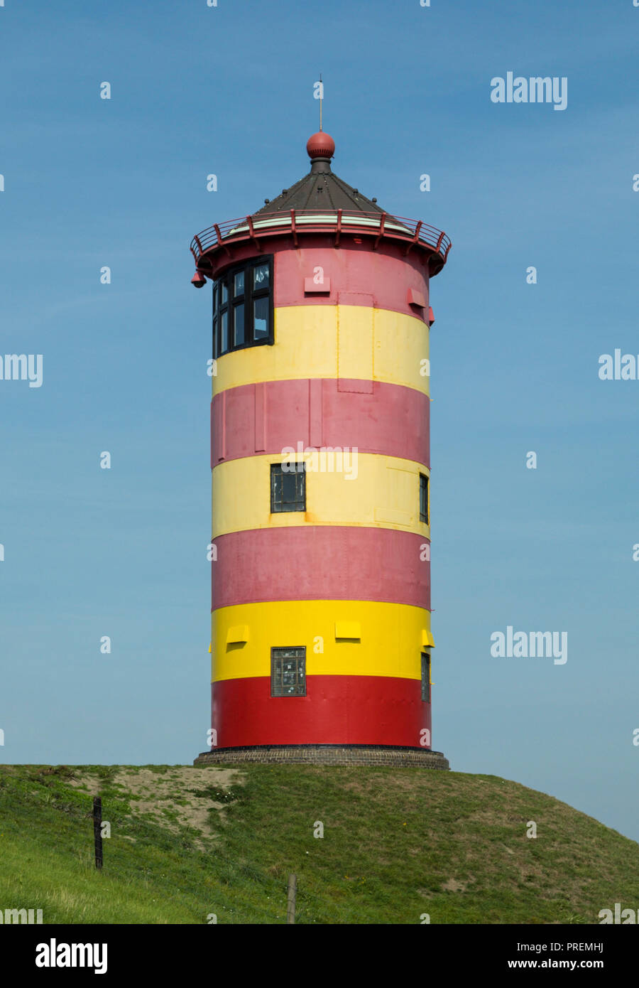 Famous small lighthouse of Pilsum, East Frisia, German North Sea region - Stock Image