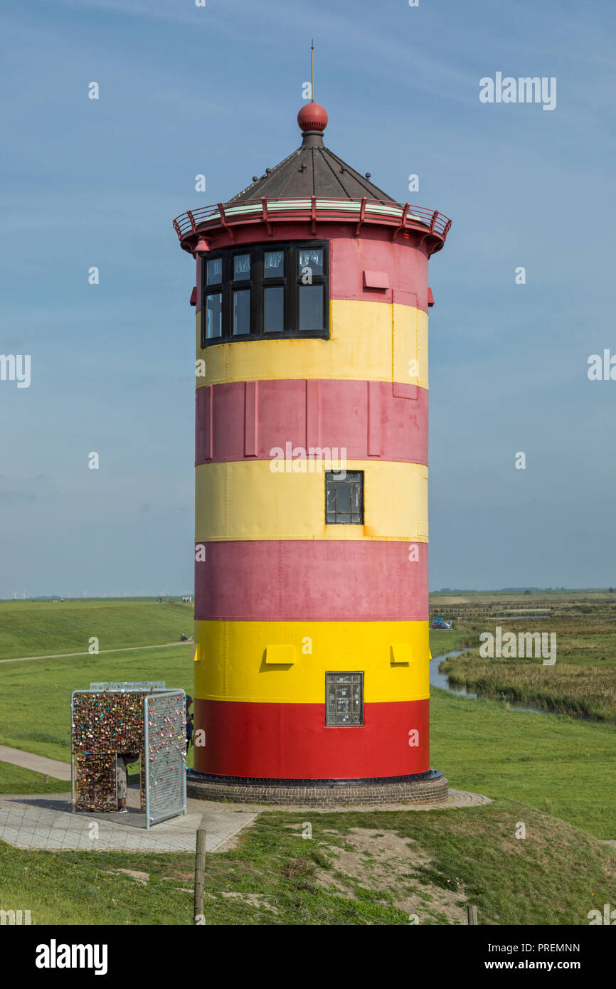 Famous small lighthouse on the North Sea dike at Pilsum, East Frisia, Germany - Stock Image