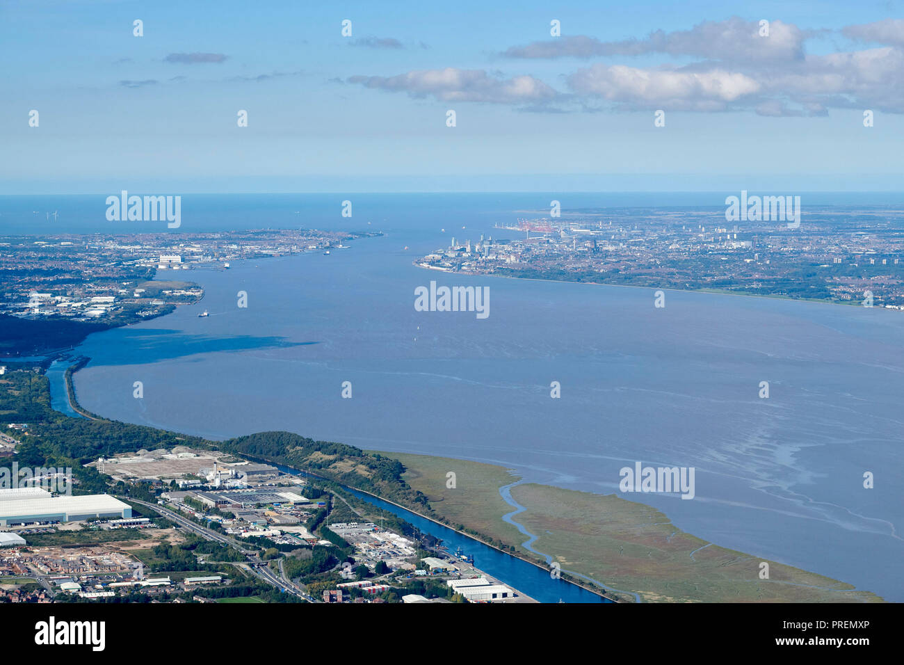 An aerial view of the Mersey Estuary, Birkenhead left and Liverpool right, north west England, UK, shot from Ellesmere Port - Stock Image