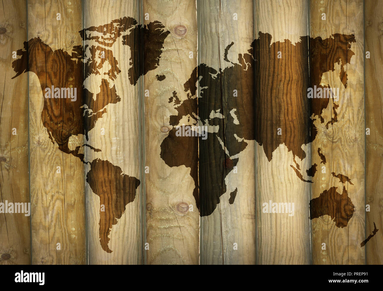 Shadow of a world map projecting on wooden planks as a ...