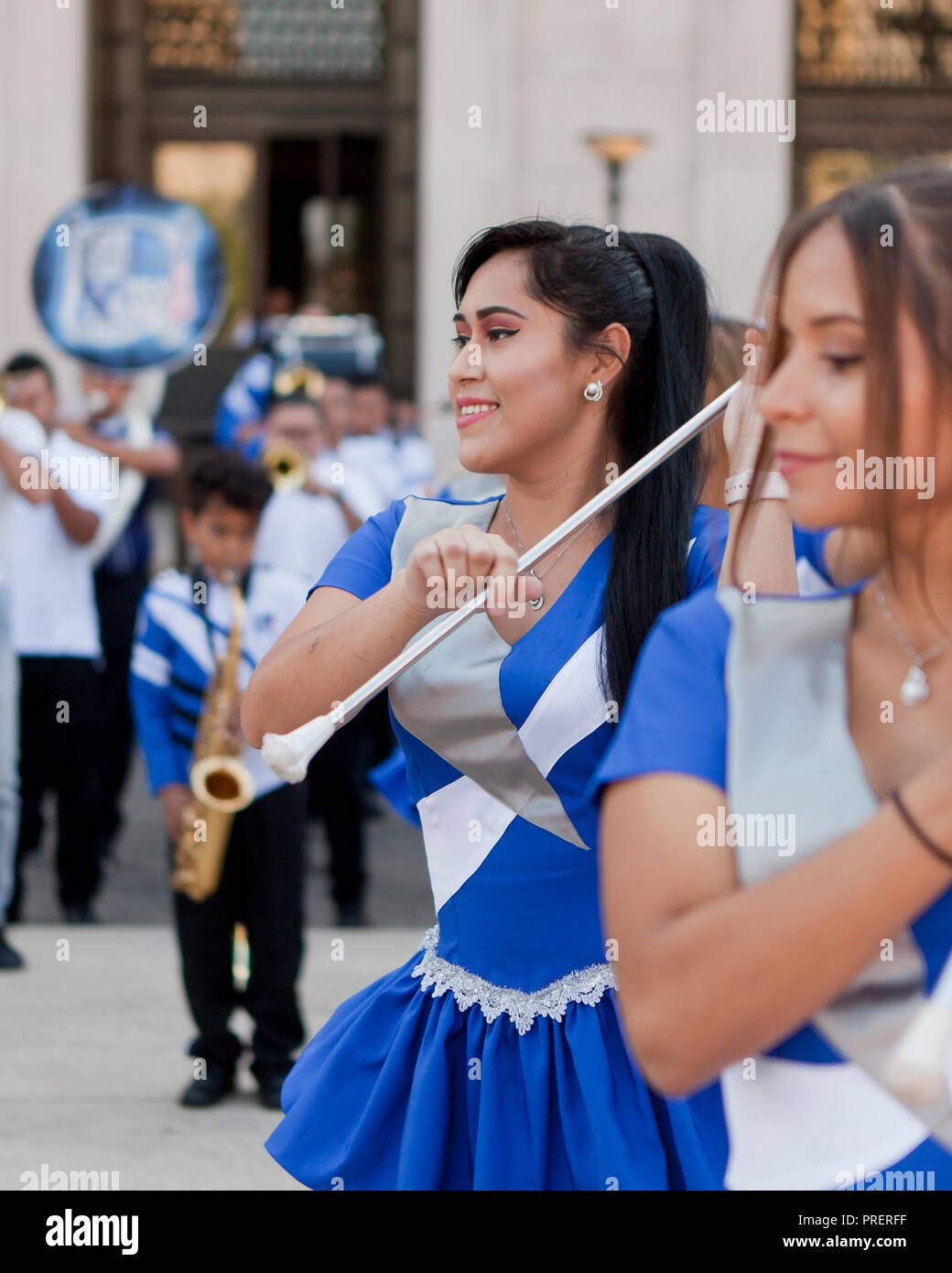 Salvadoran cheerleaders dancing with batons - USA - Stock Image
