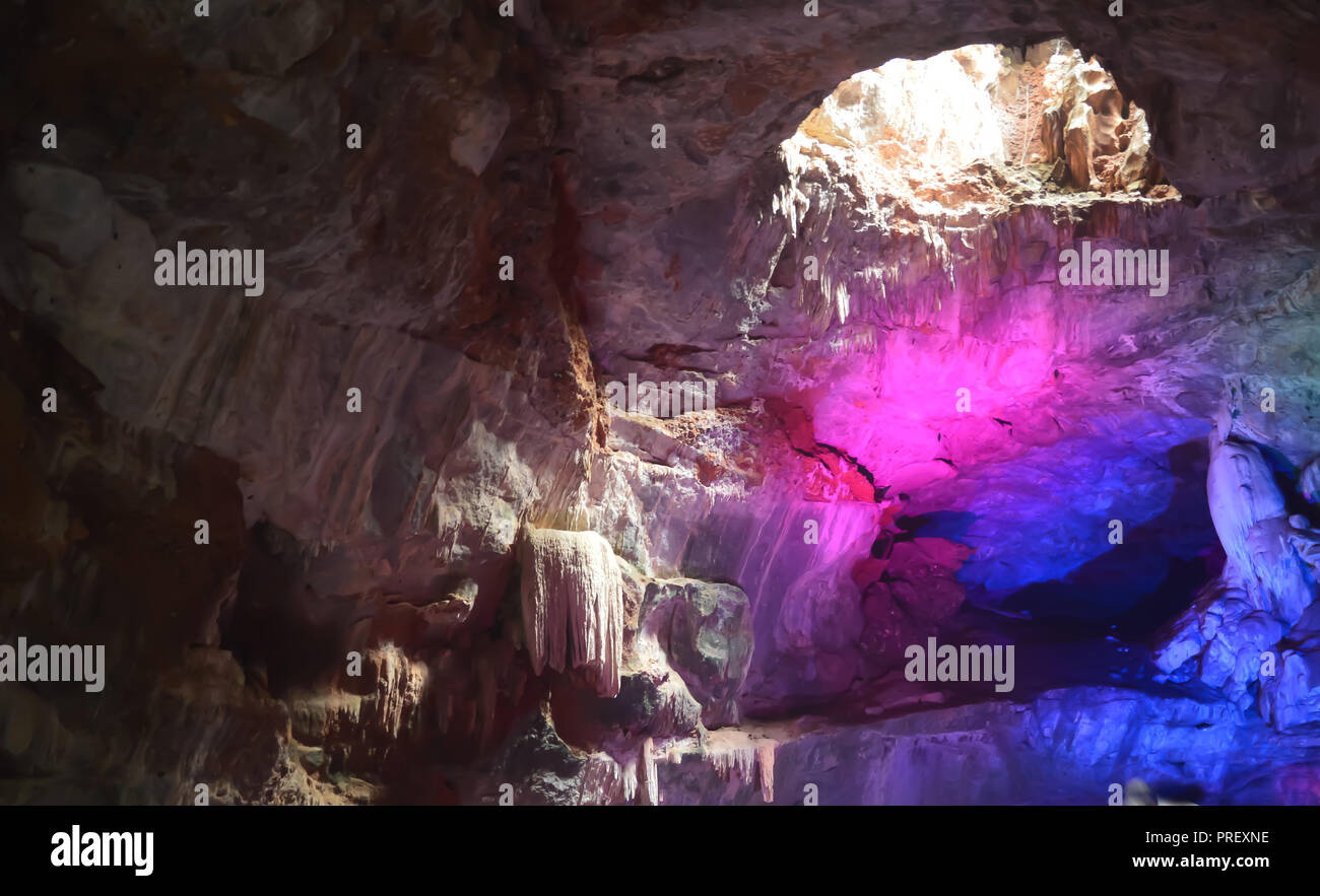 Inside view of Borra Caves formed by solidified stalactites and stalagmites in the karstic limestones formation located in the Araku Valley - Stock Image