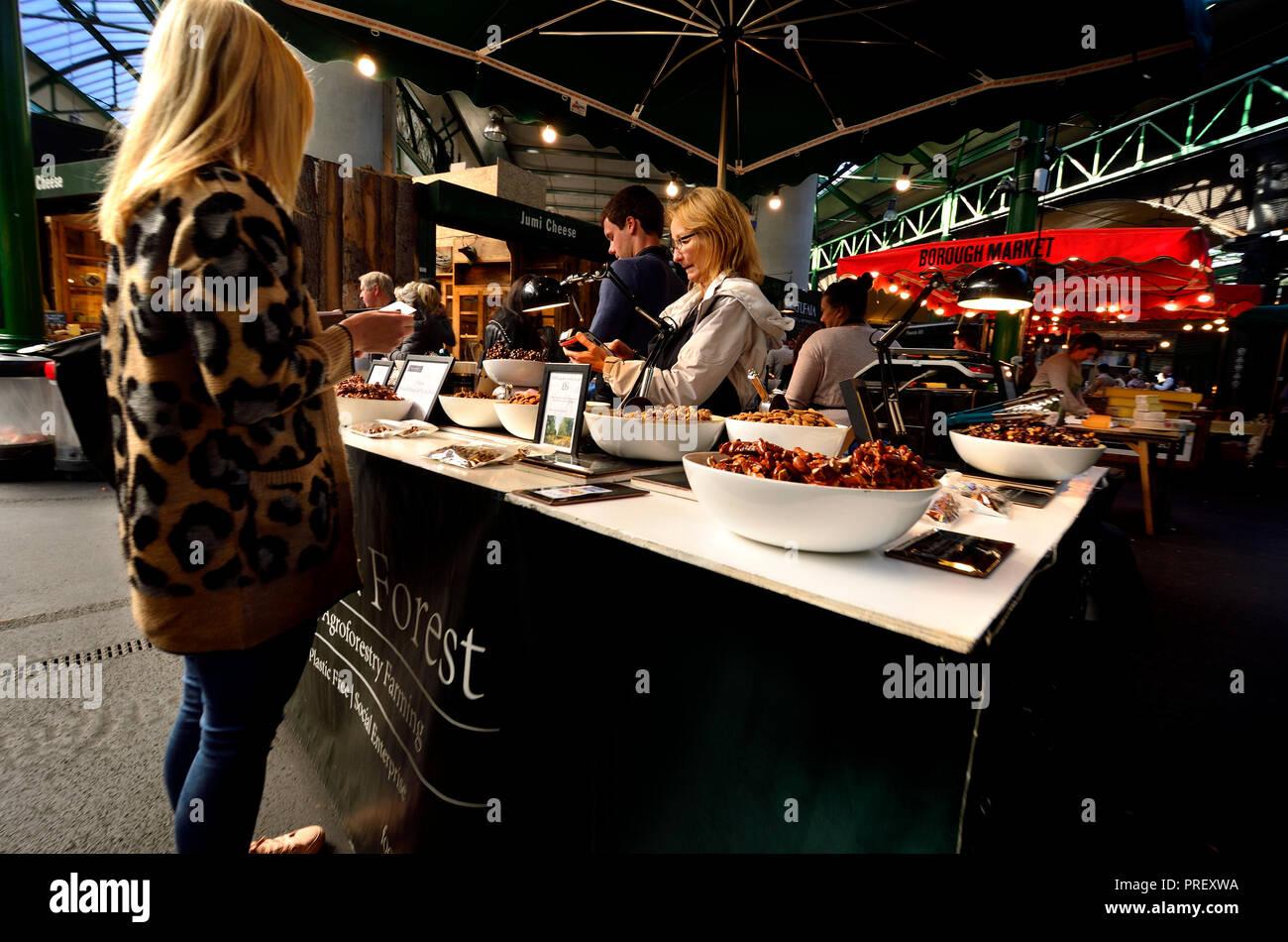Nut stall in Borough Market, Southwark, London, England, UK. - Stock Image