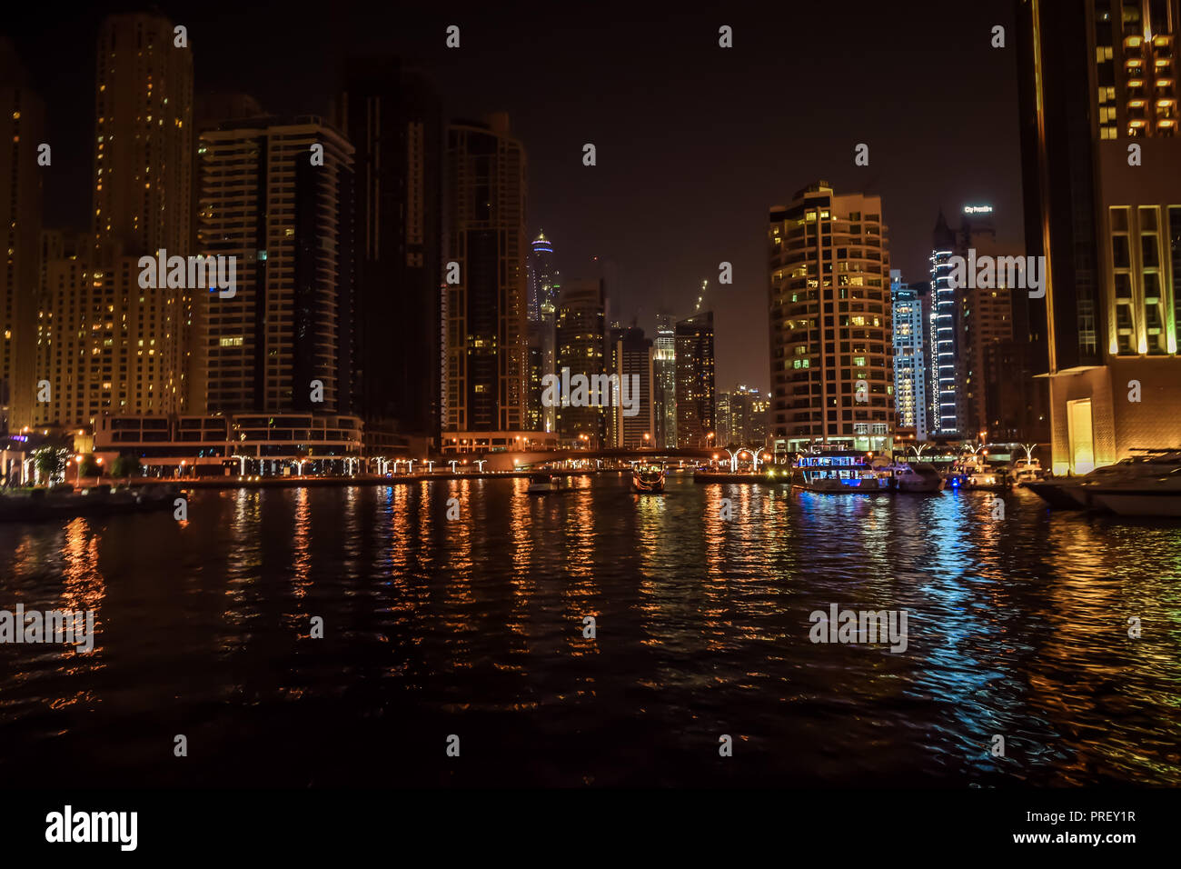DUBAI, UNITED ARAB EMIRATES - UAE - Asia 23 APRIL 2016: Skyscrapers of City Marina at night. Panoramic skyline view lights and reflections. Famous - Stock Image