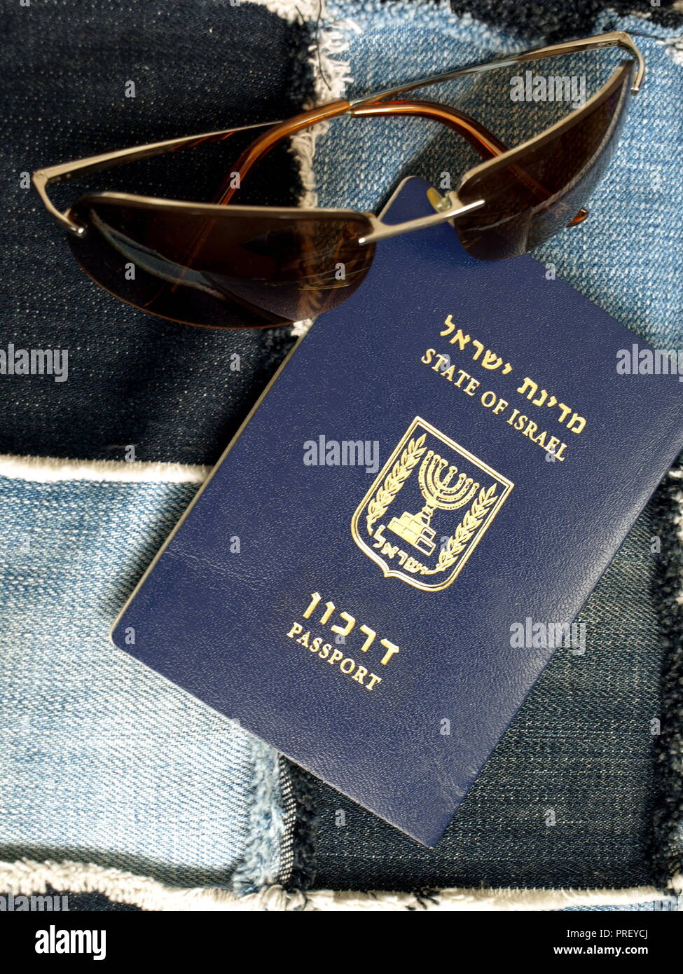 Israeli passport (translation: State of Israel. Passport) and glasses from the sun. Stock Photo