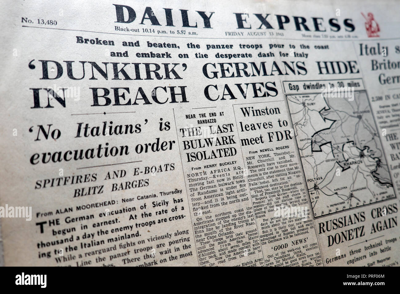Front page headlines of the Daily Express newspaper  'Dunkirk Germans Hide in Beach Caves'  London EnglandUK August 1943  historical archive - Stock Image