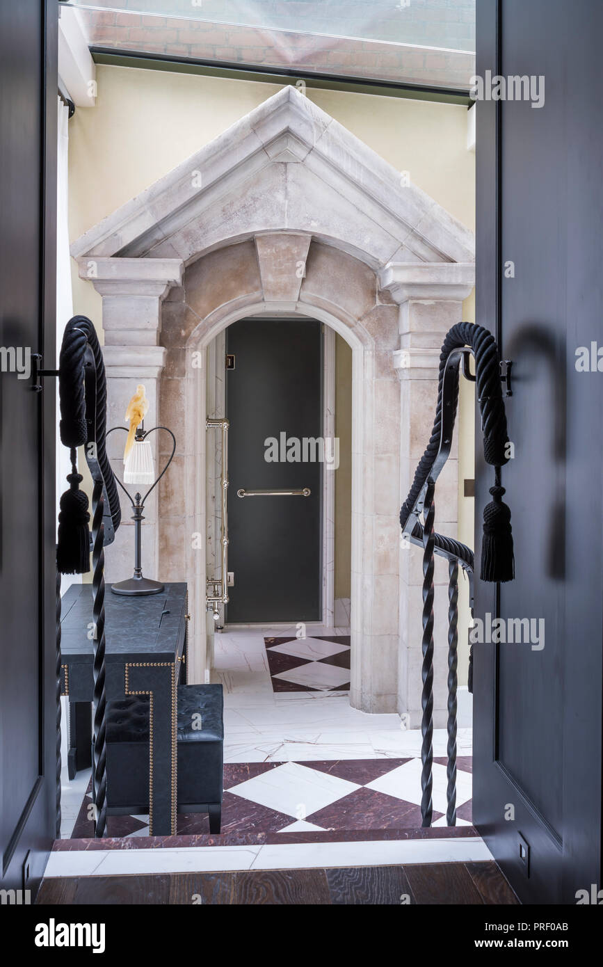 Stone pediment, originally a window surround as entrance to shower - Stock Image