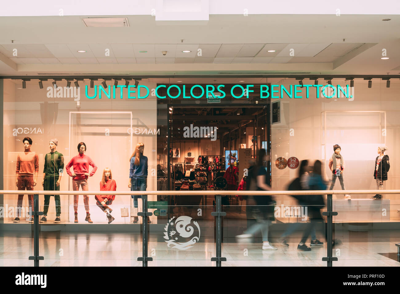 Warsaw, Poland - September 27, 2018: People Walking Near United Colors of Benetton Store In Shopping Mall - Stock Image