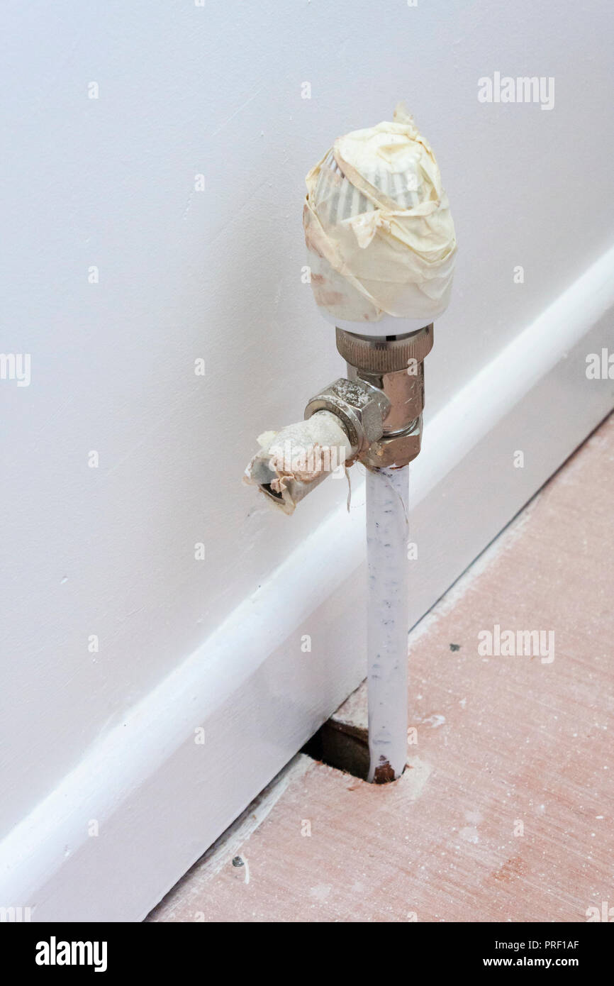 Plumbed in pipework ready for radiator fitting installation - Stock Image