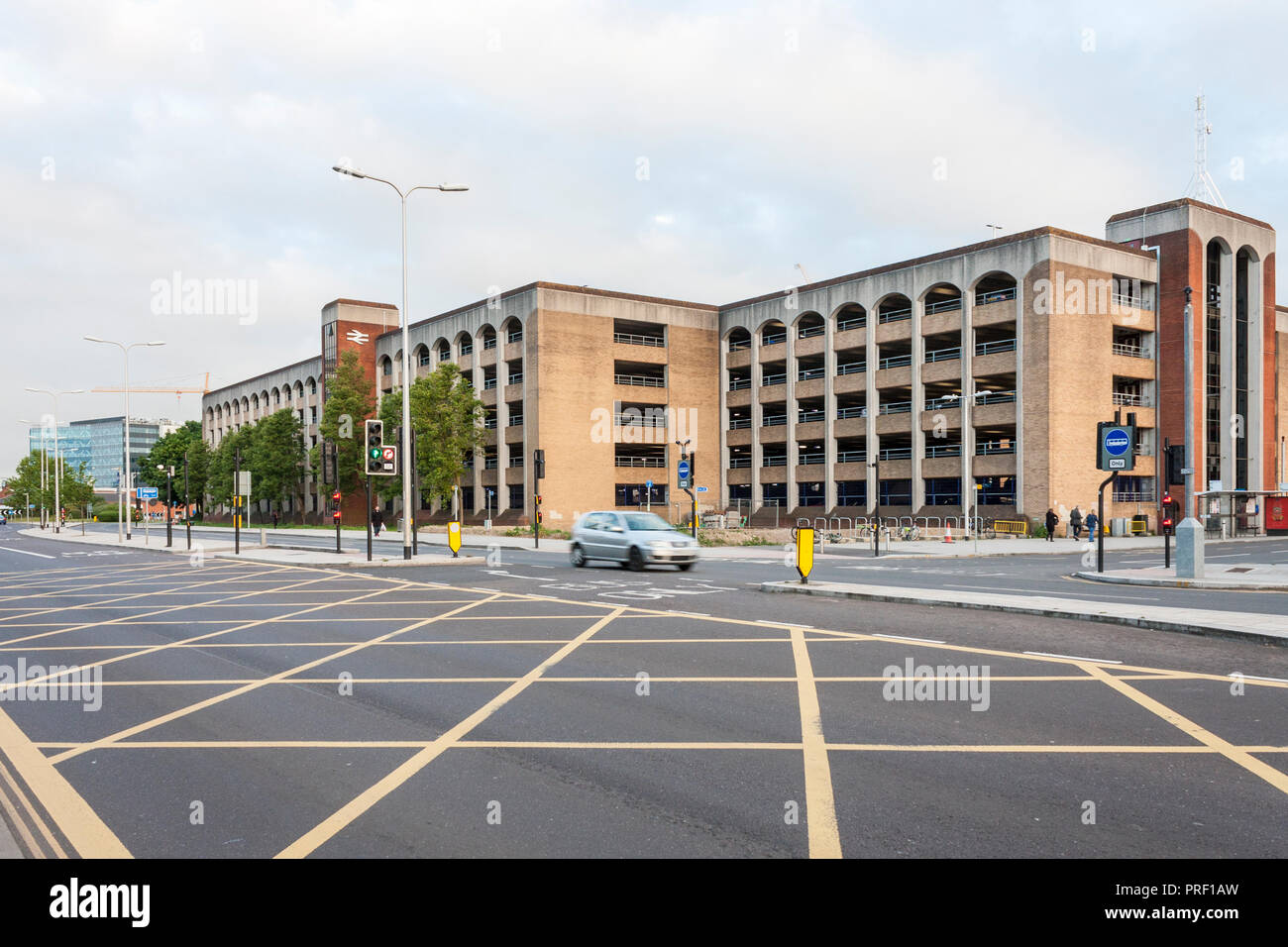 Multi-storey car park at Reading Train Station view from yellow box junction on road. - Stock Image