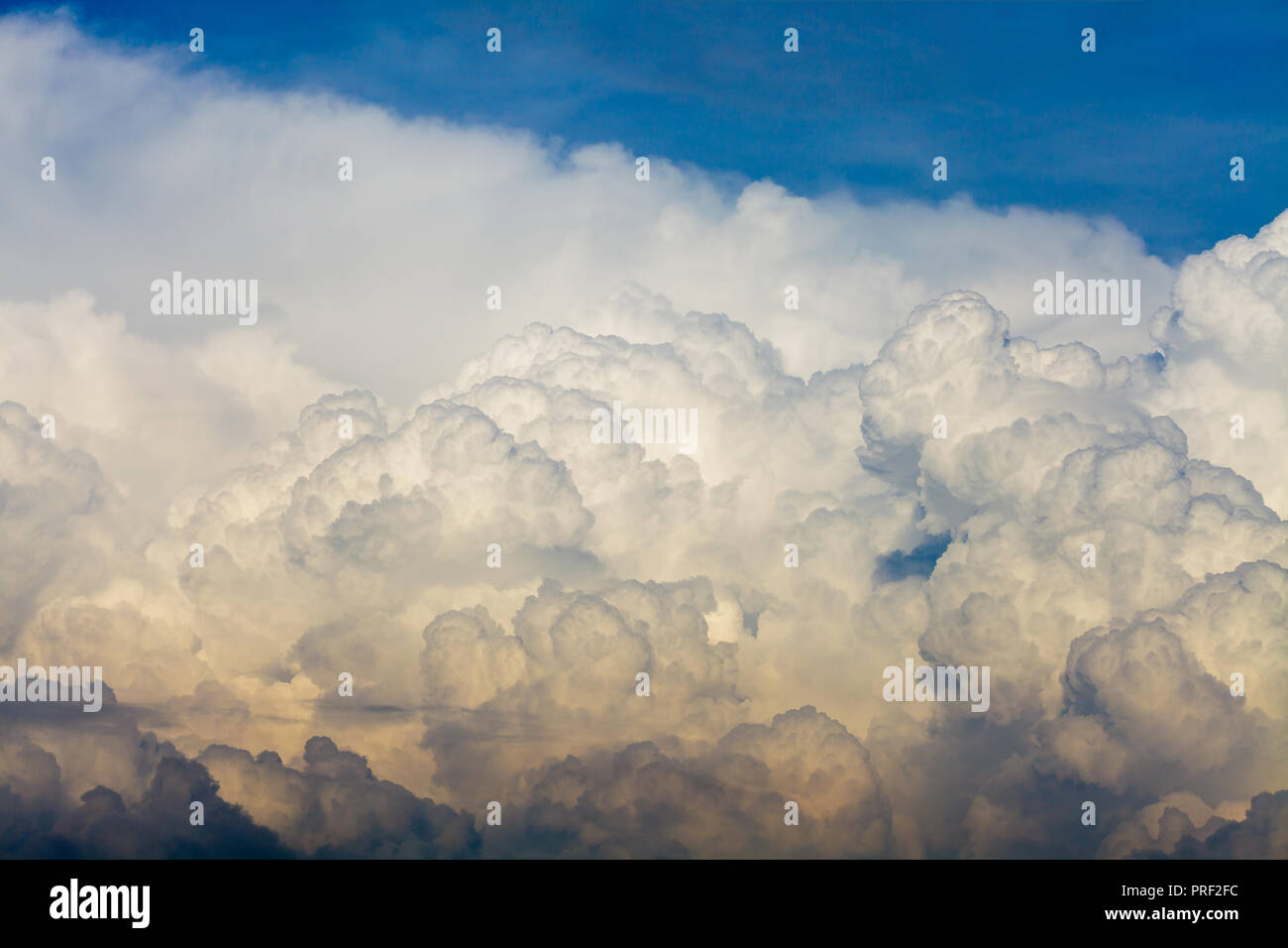 Cumulonimbus clouds against blue sky - Stock Image