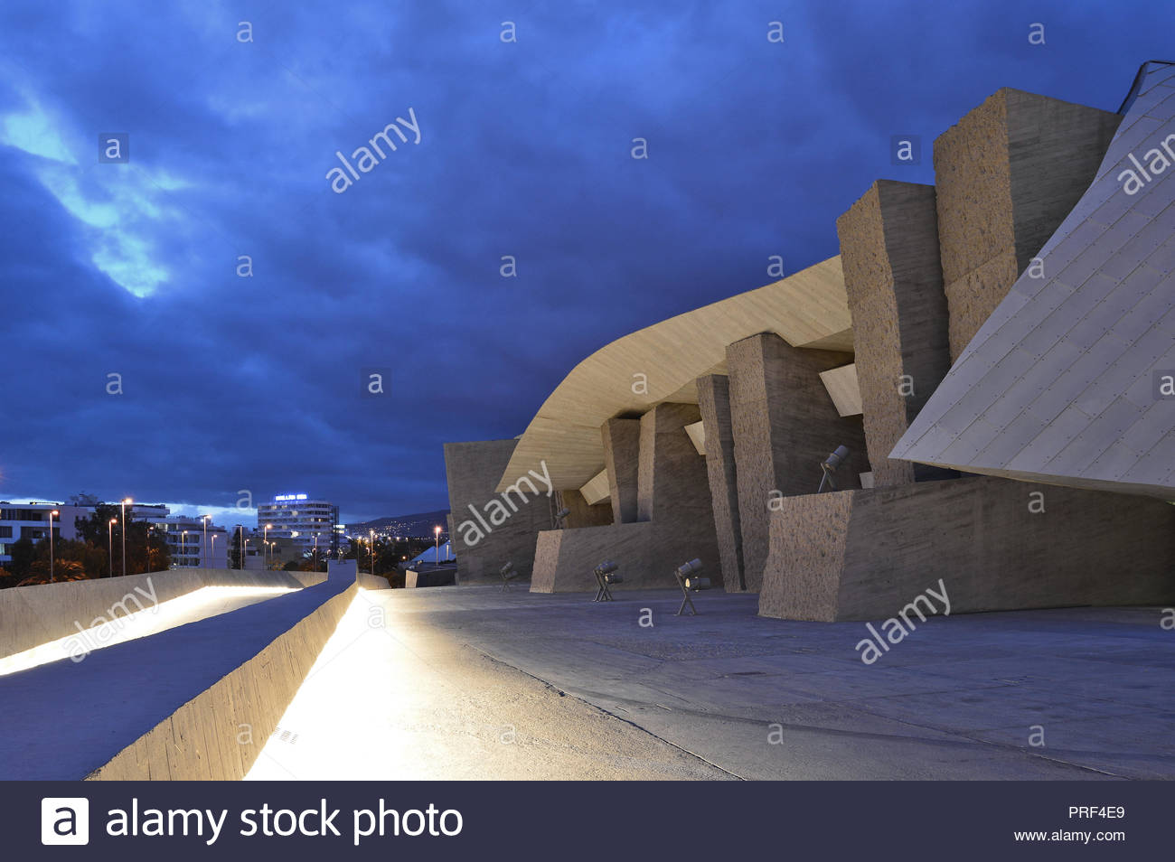 Magma Arts And Congress Center, modern architecture illuminated at dusk. Costa Adeje Tenerife Canary Islands Spain. Designed by Fernando Menis. - Stock Image