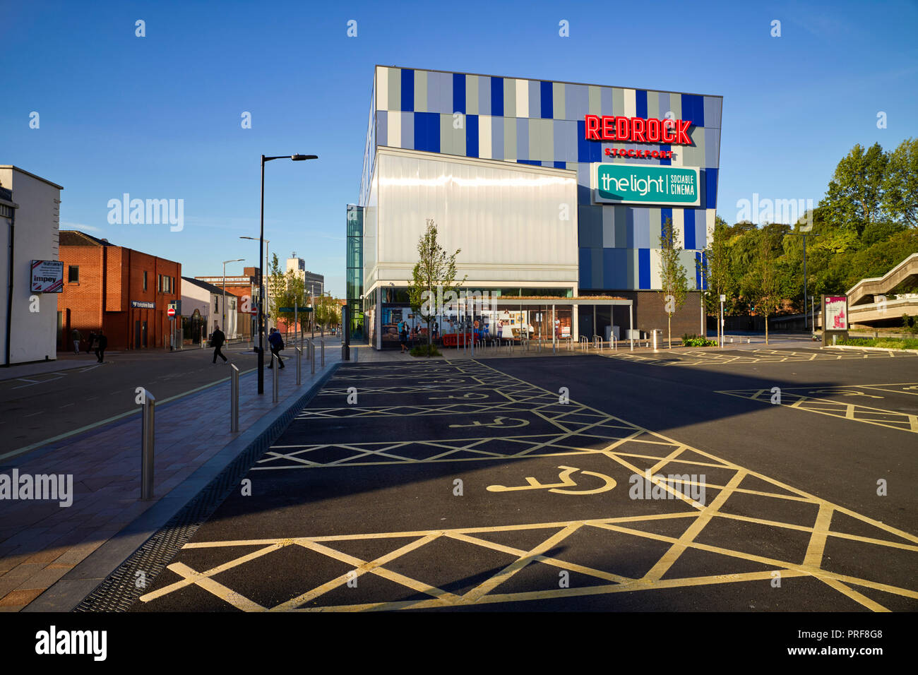 Redrock building in Stockport with multiple disabled car parking spaces - Stock Image
