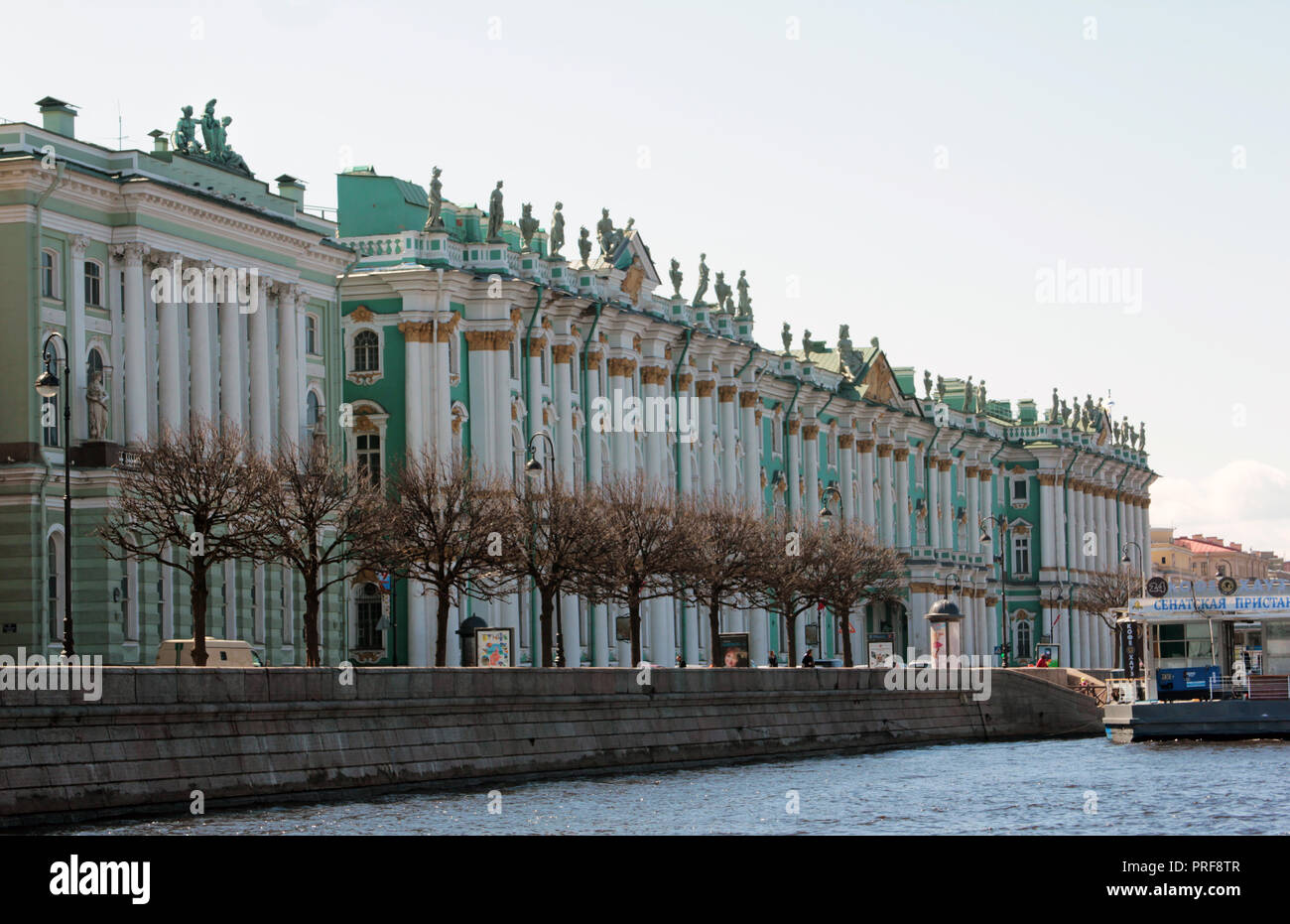 An oblique view of the colourful façade of Hermitage museum, from the River Neva in St Petersburg, Russia. - Stock Image