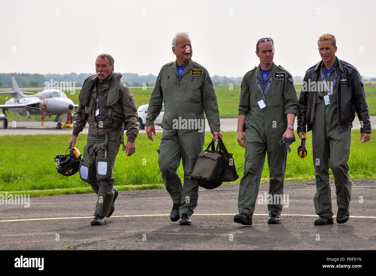 Pilots walking in having displayed classic jet planes of Midair Squadron at Cotswold Airport, Kemble. Chris Heames, Dave Piper, Gareth Walker - Stock Image