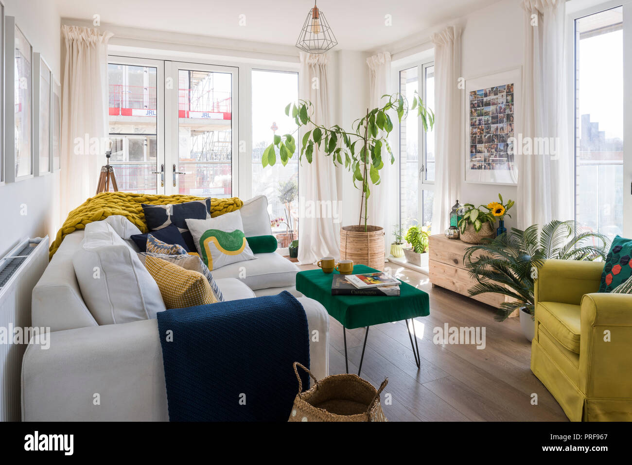 Upholstered sofa and armchair in London apartment - Stock Image