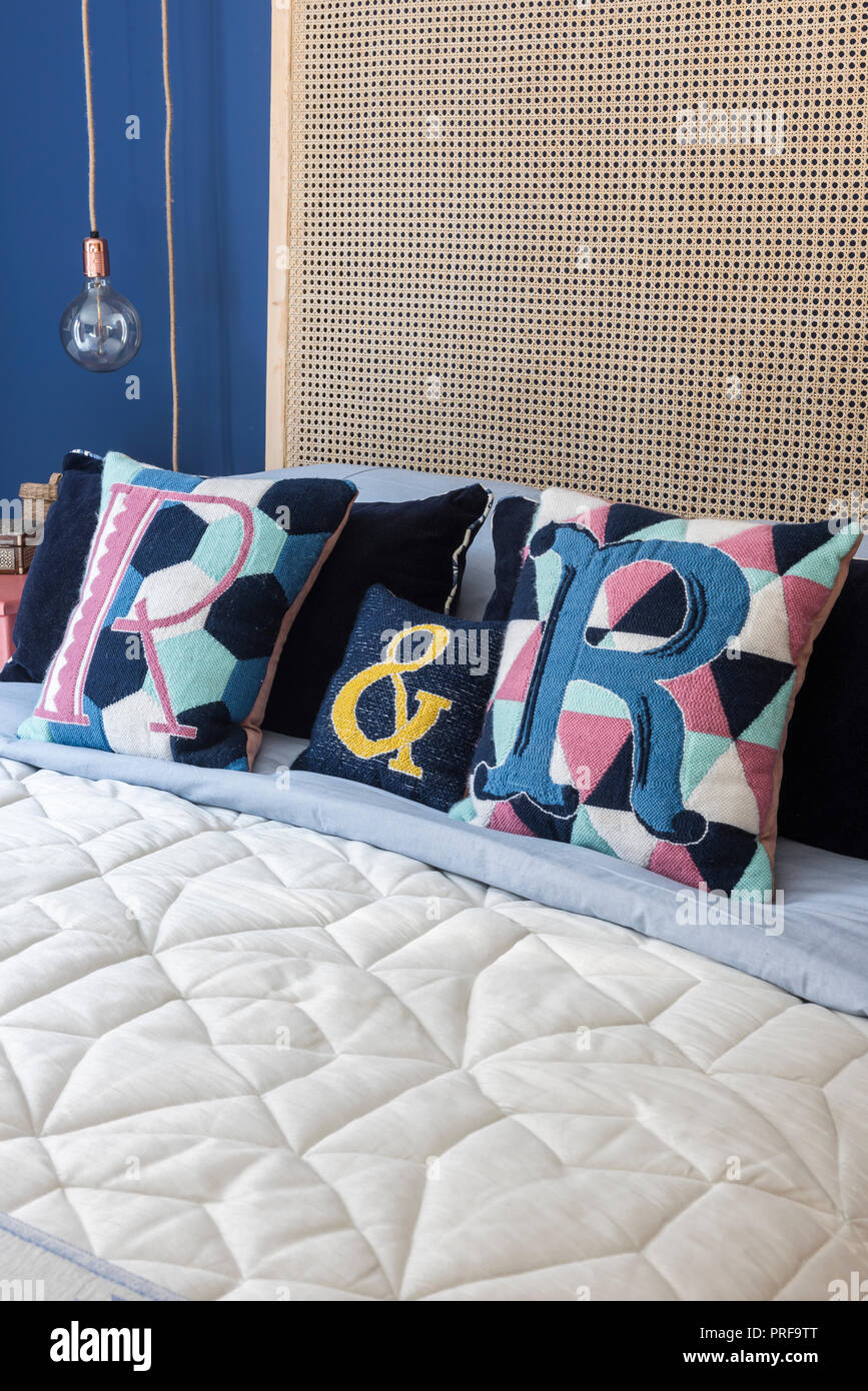 Letter 'R' cushions with headboard and filament lightbulb Stock Photo