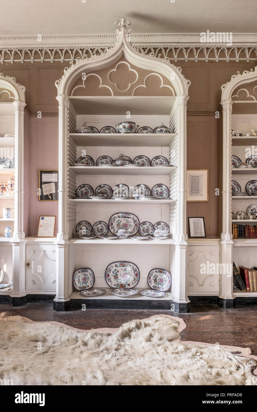 Decorative plates on white shelving unit in strawberry hill gothic syle