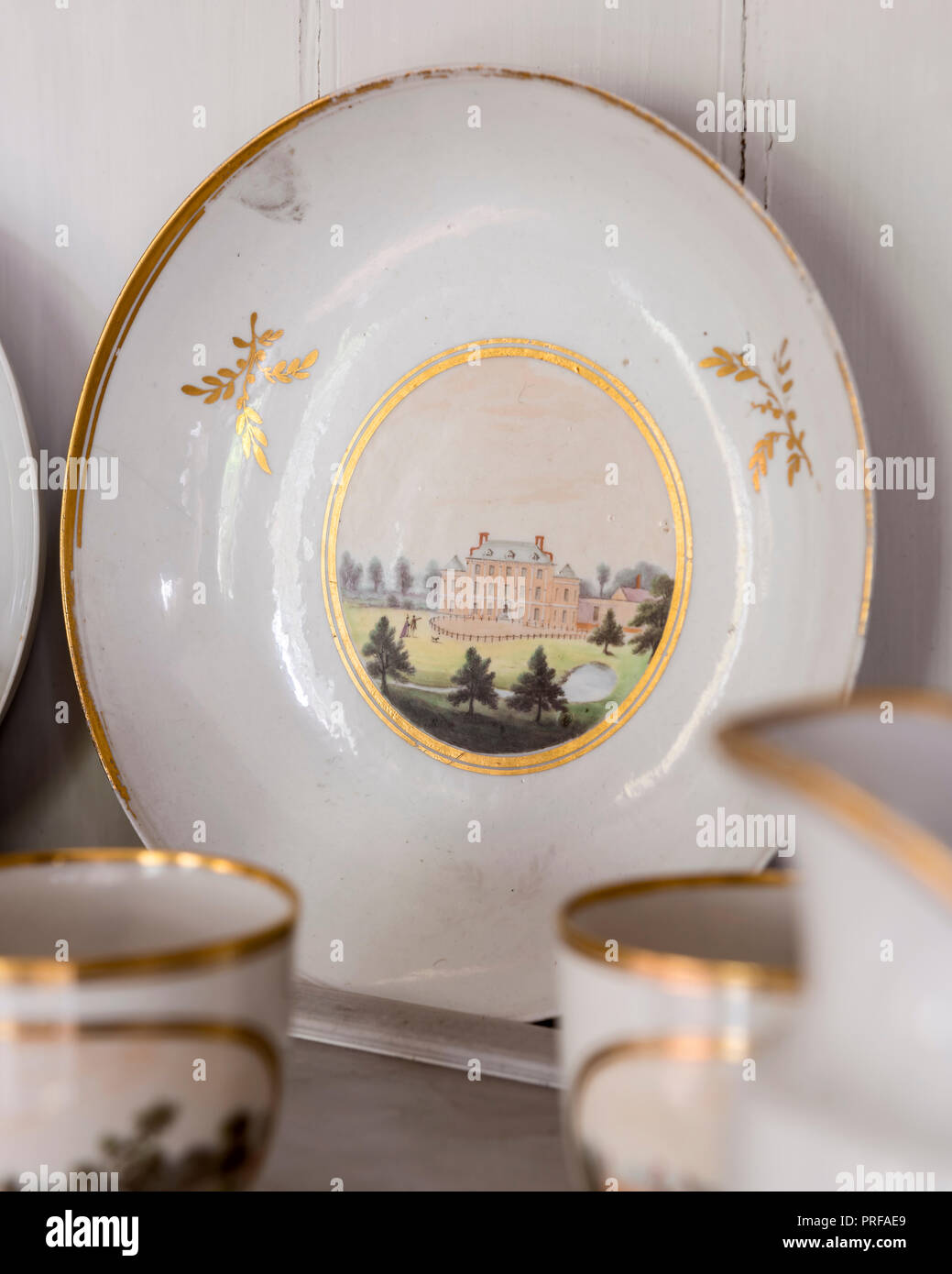 Hand painted crockery with facade of Milton Hall - Stock Image
