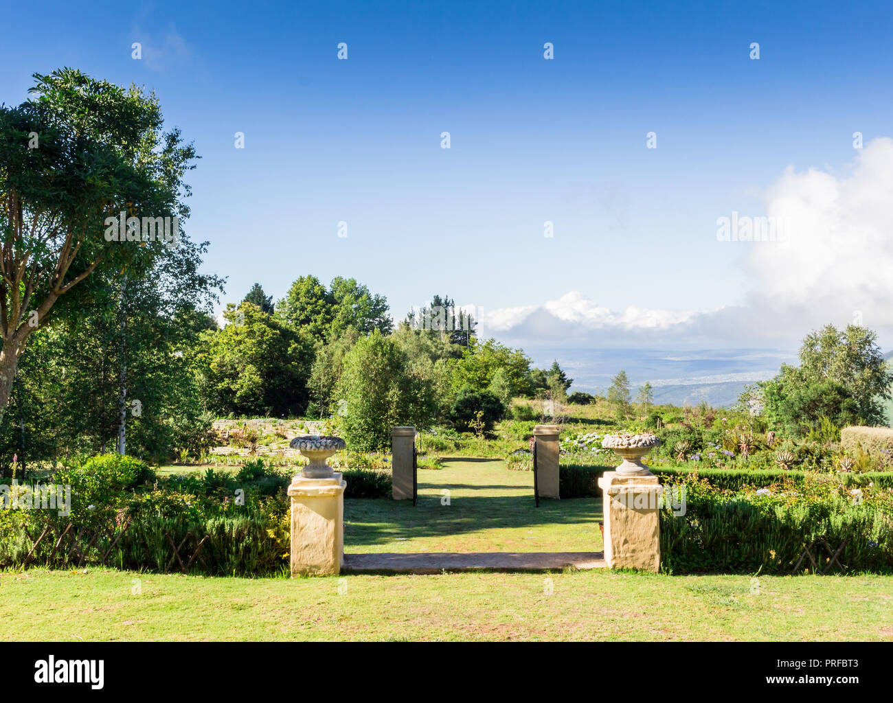 Formal Garden With Walls And Ornamental Plant Pots On The Edge Of Hogsback,  Eastern Cape, South Africa Overlooking A Valley, With Labyrinth In Backgou