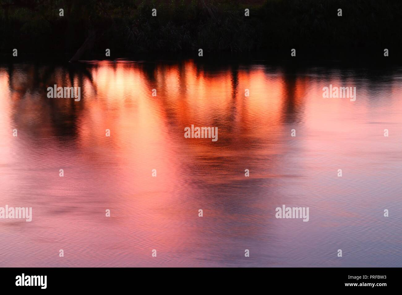 Colorful Water texture reflex beautiful colored sky in evening - Stock Image