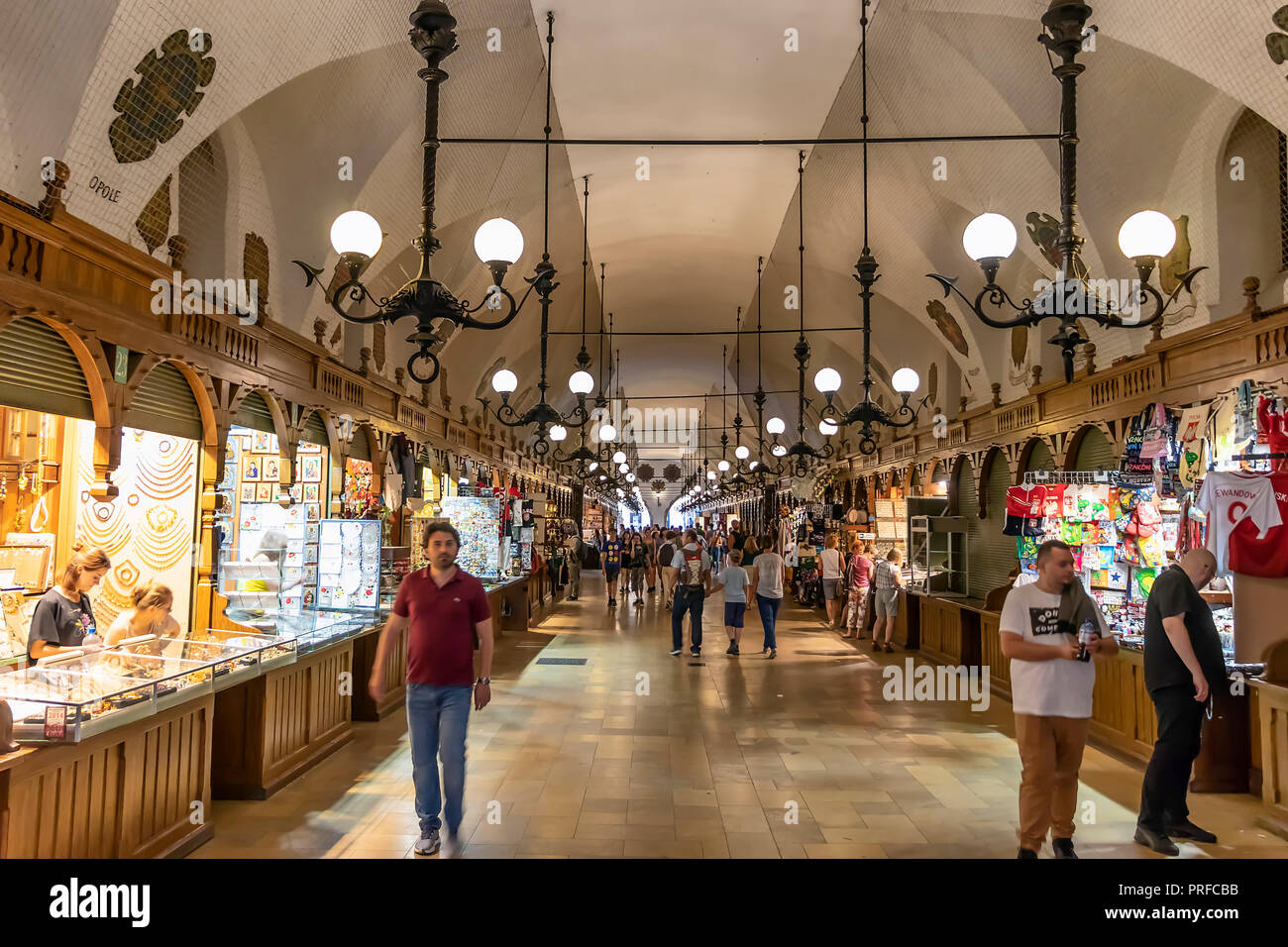Krakow, Poland June 5, 2018: Interior of gallery of Cloth Hall with visitors walking along the stalls. Cloth Hall is the central feature of Main Marke - Stock Image