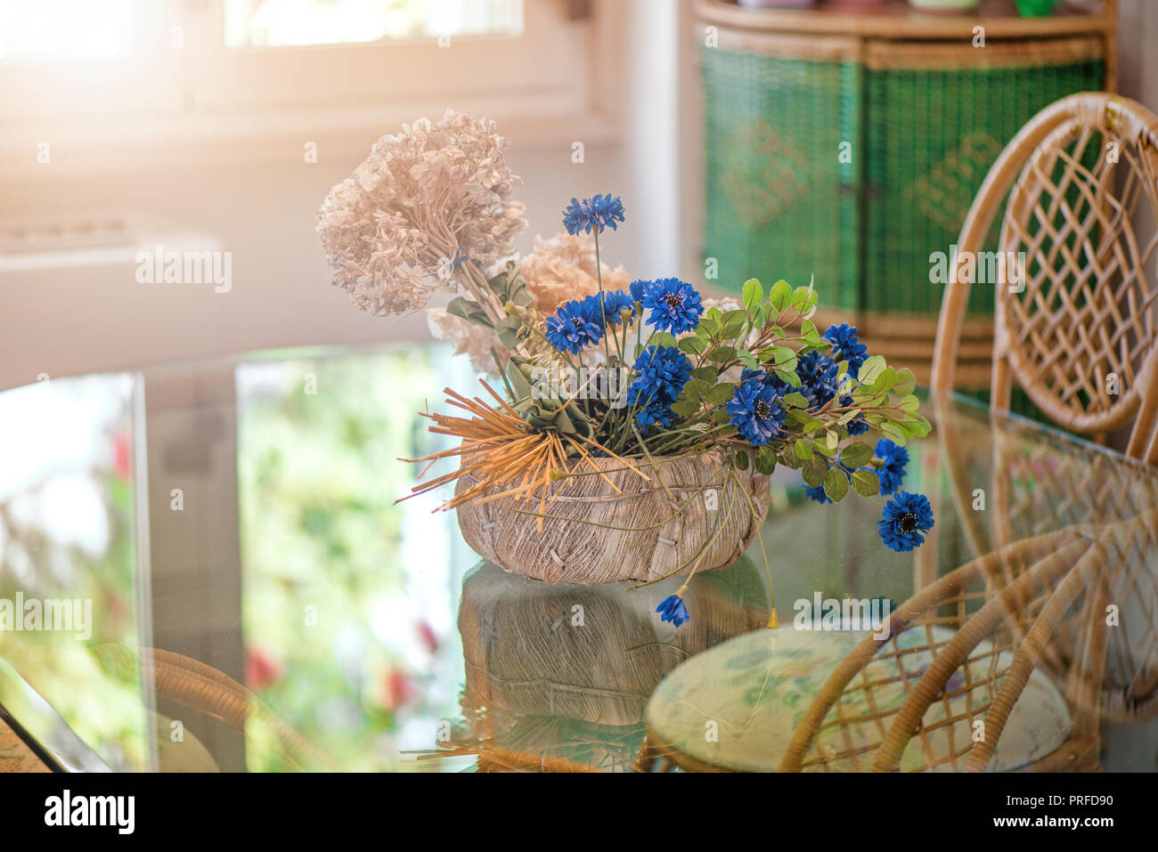 Dining Room With Big Glass Table And Decorations All Around The Place Dried Flowers Wicker Chairs Clay Pottery Cozy Atmosphere At Home Concept Of Stock Photo Alamy