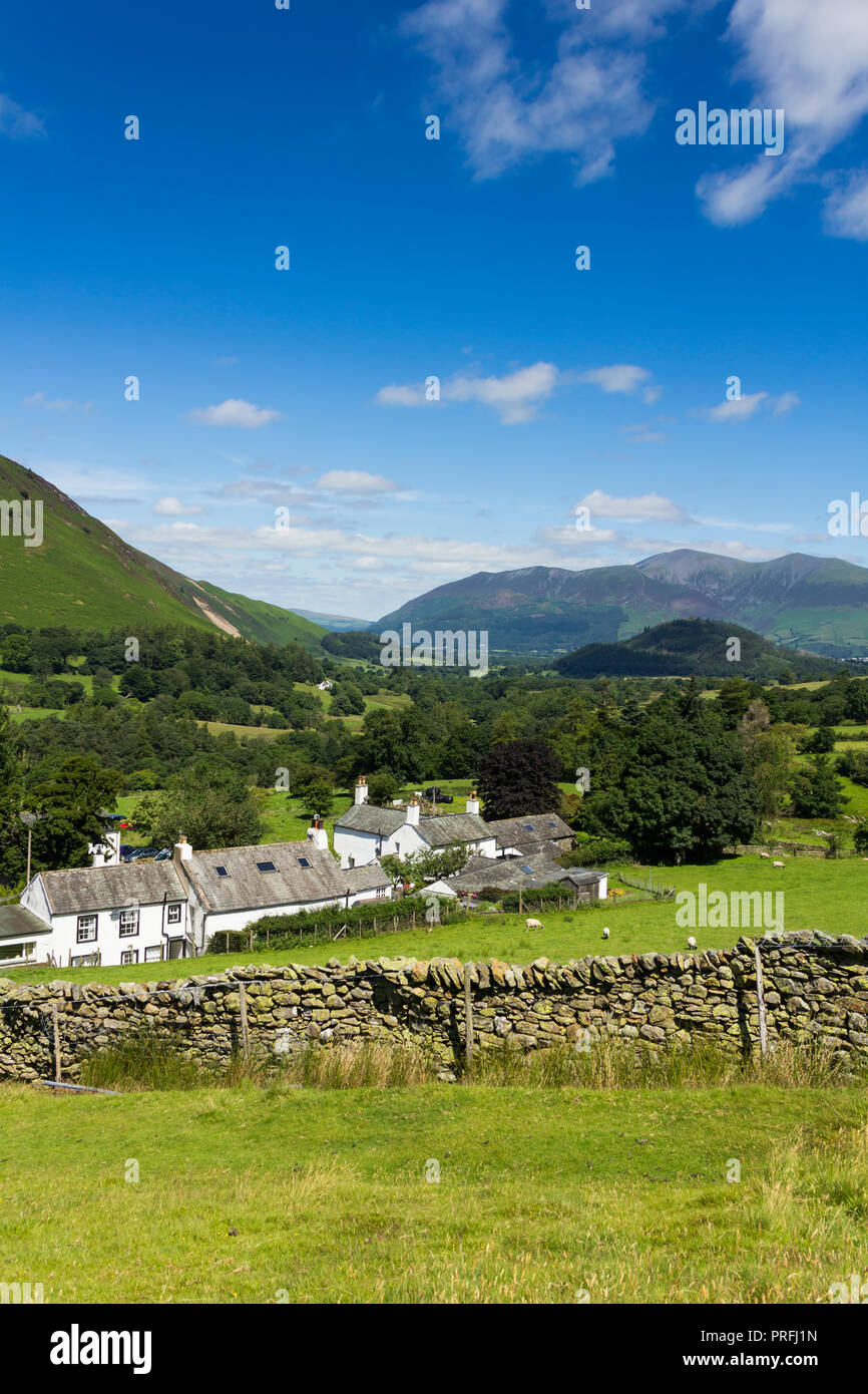 Newlands valley Cumbria, looking north over the hamlet of Littletown, towards Swinside and the distant mountain of Skiddaw with Rowling End rising to  Stock Photo