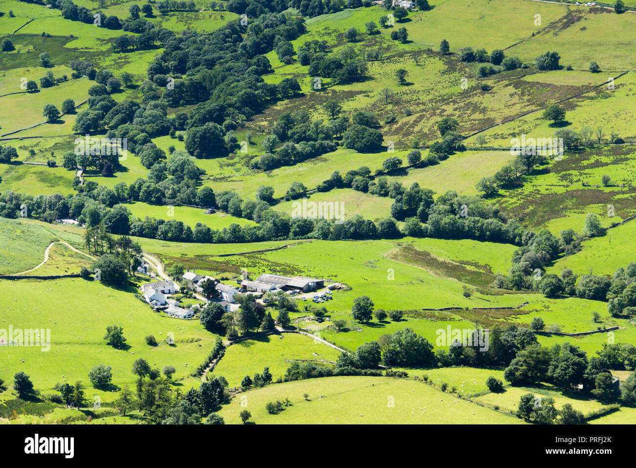 From the summit of Cat Bells,  looking down on the hamlet of Littletown and fields of green in Newlands valley Cumbria. Stock Photo