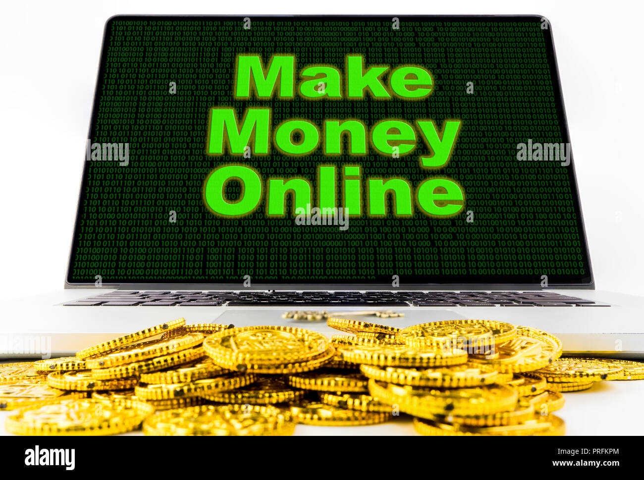 Make money online on computer screen with golden coins Stock Photo