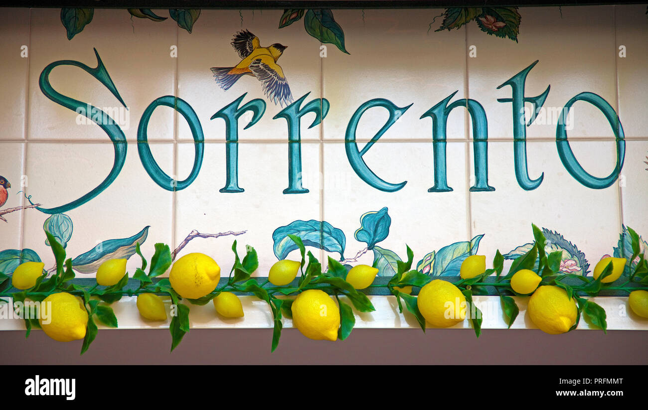 Tile picture with letters Sorrento, decorated with lemons, old town of Sorrento, Peninsula of Sorrento, Gulf of Naples, Campania, Italy - Stock Image