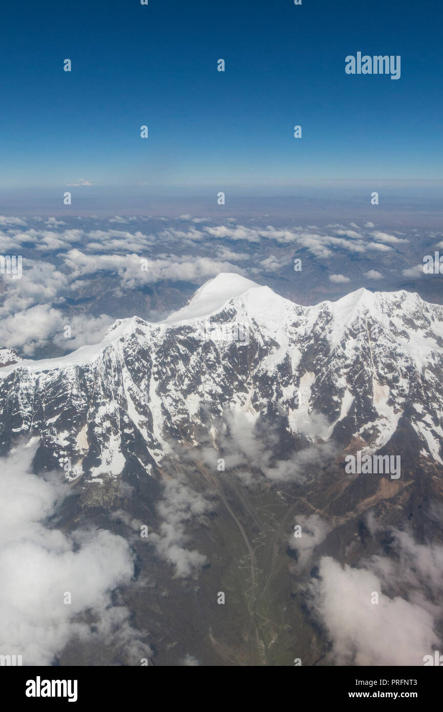 Aerial view of Huayna Potosi. The Cordillera Real is a mountain range in the South American Altiplano of Bolivia. This range of fold mountains, largel - Stock Image