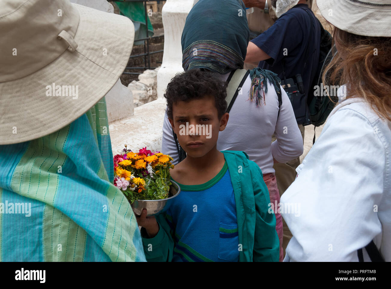 A boy sells flowers to tourists in May 10, 2007 in Jibla, Yemen. Among other arabic countries, in 2012 Yemen became a site of civil conflicts. - Stock Image