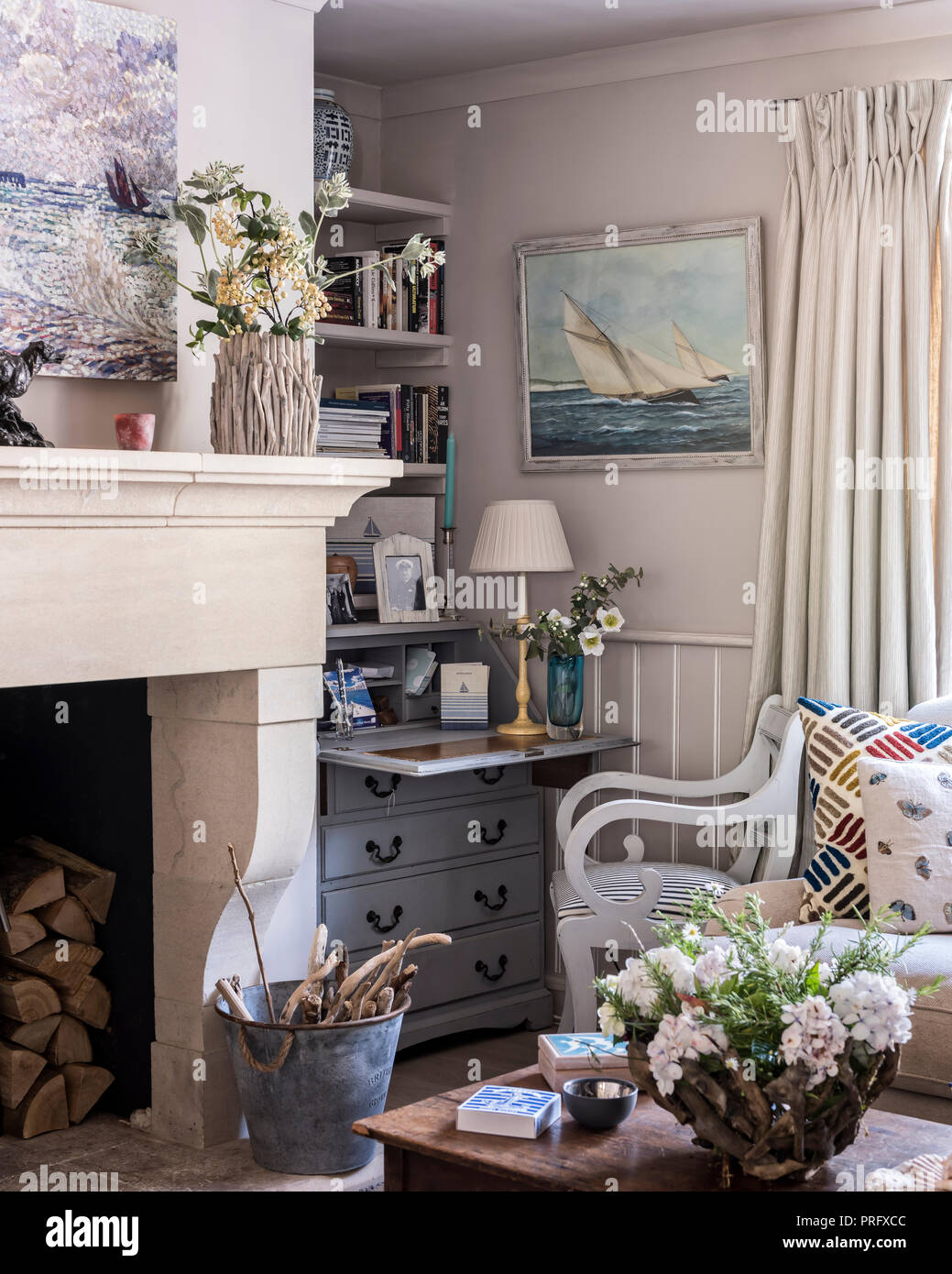 Writing desk and chair with cut flowers in Devon cottage - Stock Image