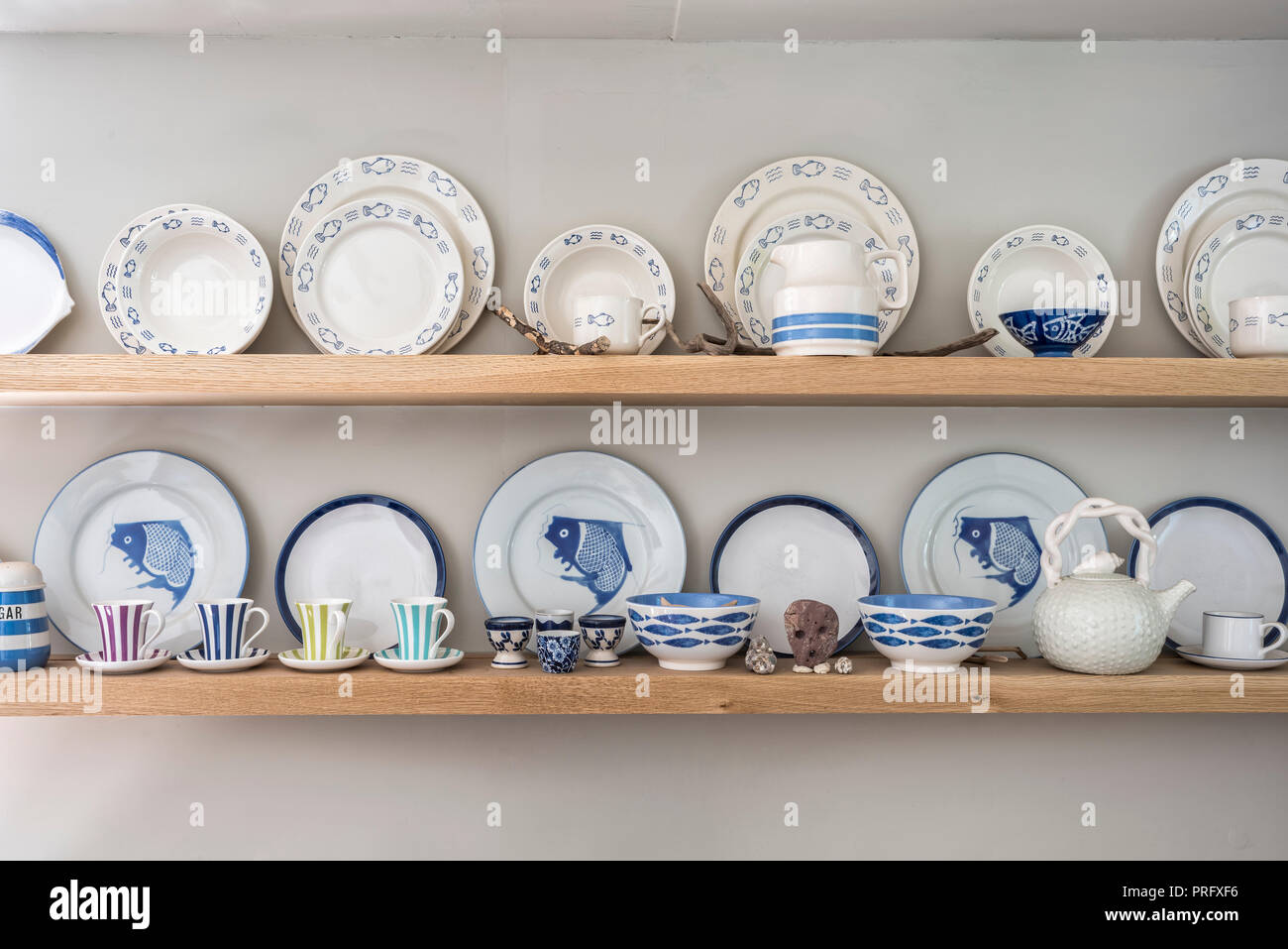 Collection of blue and white crockery on kitchen shelves in Devon cottage - Stock Image