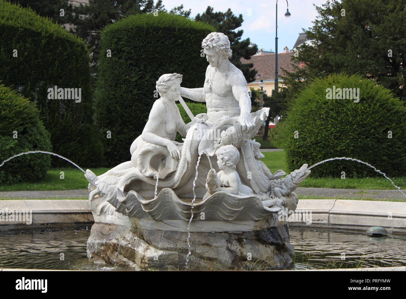 Triton And Mermaid Fountain Craved In White Marble In Maria Theresa Square  In The Old Town