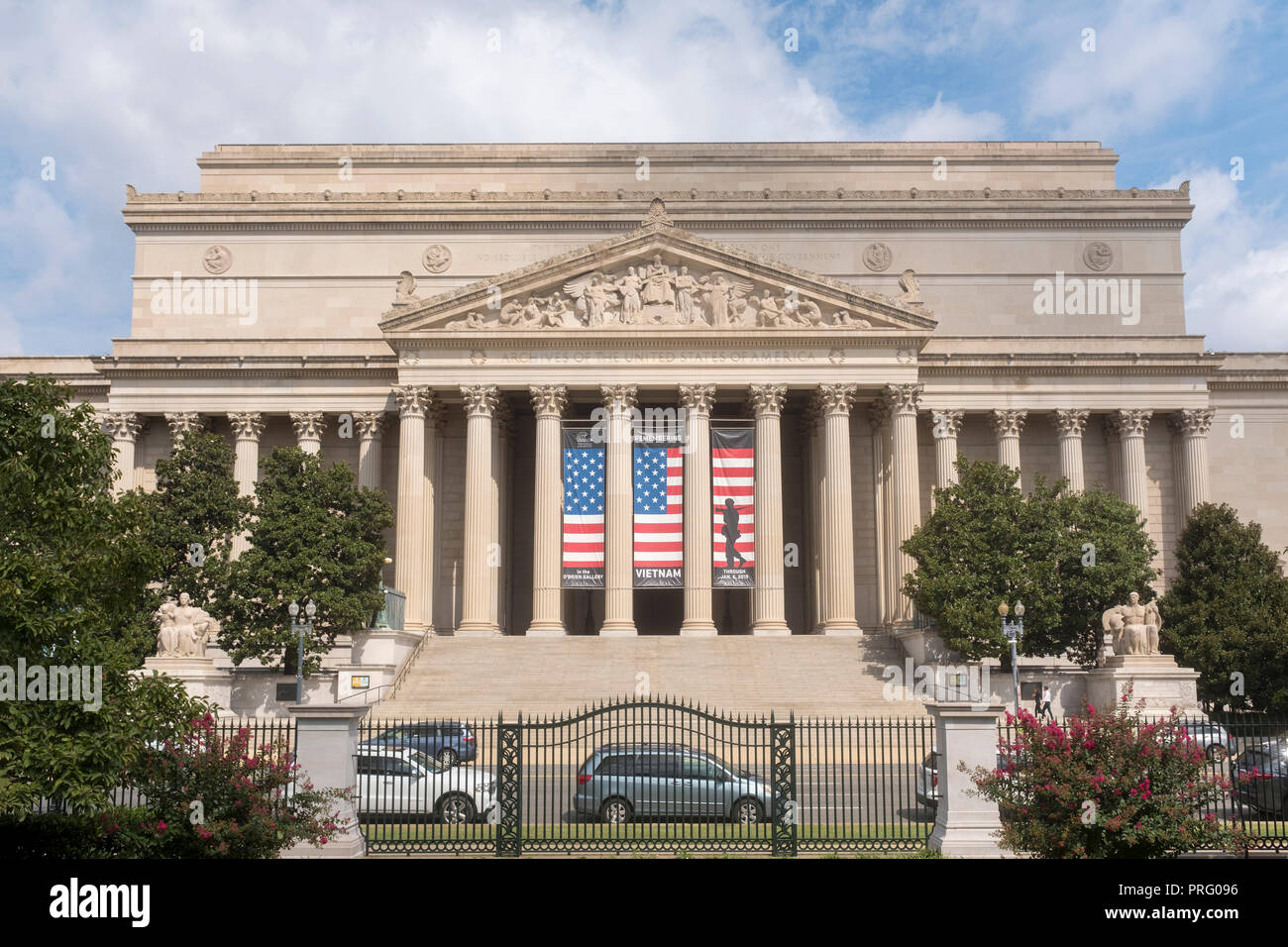 National Archives in Washington, DC, houses the original Declaration of Independence and the U.S. Constitution. Flag banner is for an exhibit on the V - Stock Image