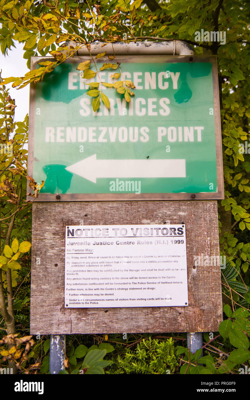 Sign for the emergency services rendezvous point and a notice to visitors warning them about what they cannot bring onto the site. - Stock Image
