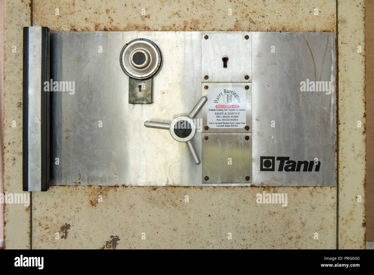 Large Tann safe in an abandoned office. - Stock Image