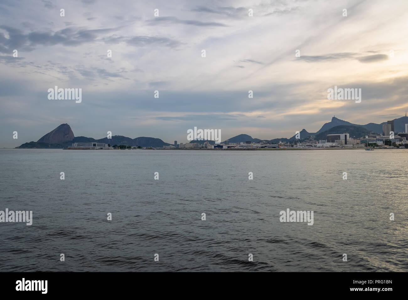 Rio de Janeiro skyline view from Guanabara bay with Sugar Loaf and Corcovado Mountains - Rio de Janeiro, Brazil Stock Photo