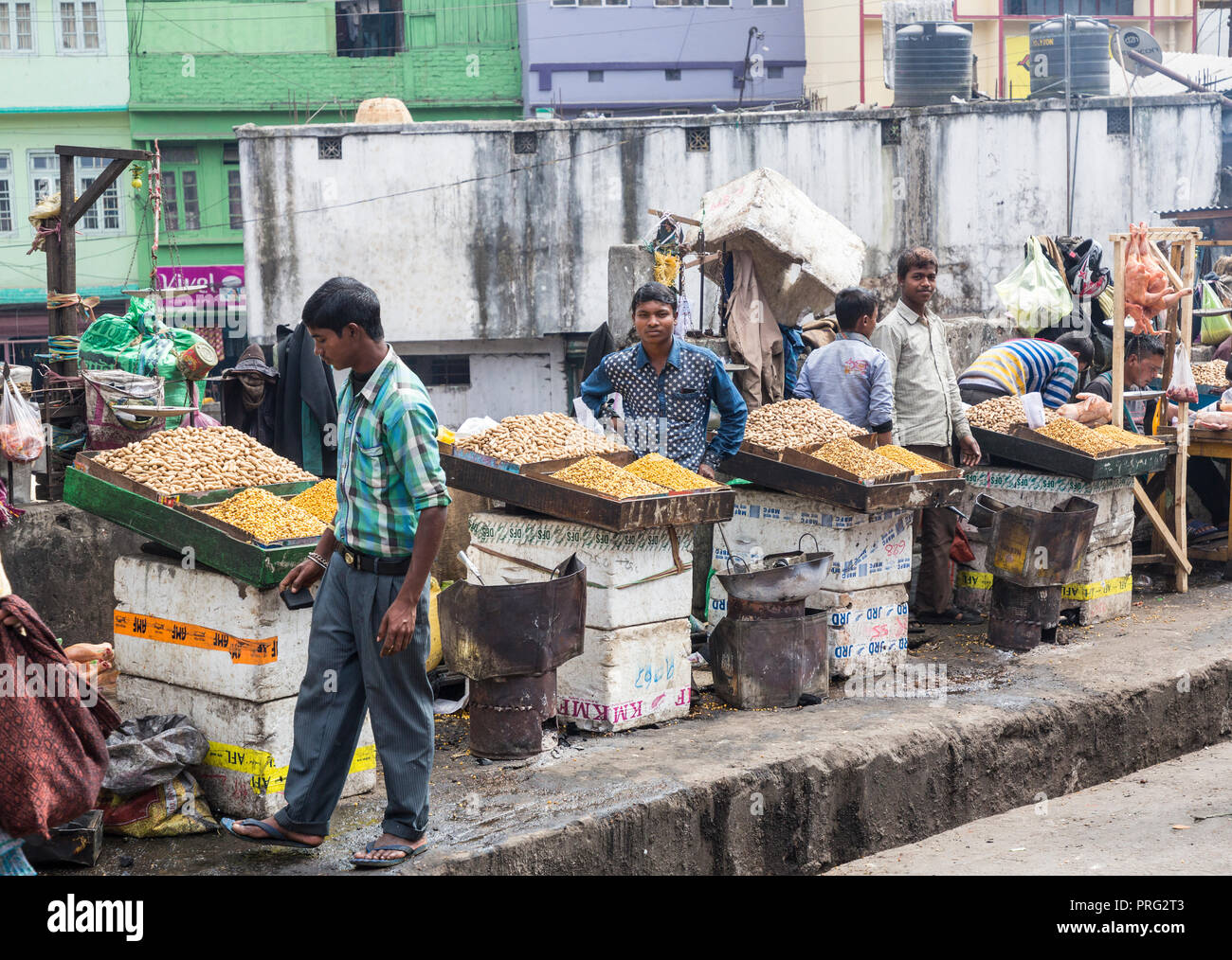 Cooked nuts on sale in street market, Shillong, Meghalaya, India - Stock Image