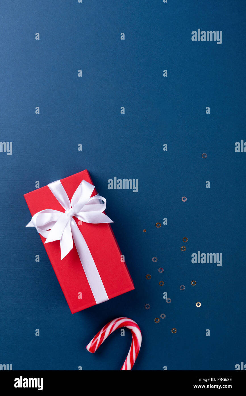 christmas gift wrapped in red paper tied with white ribbon and